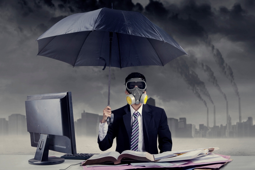 Businessman working in situation of air pollution